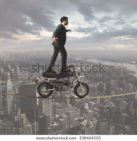 Concept of a business man who defies all obstacles - stock photo
