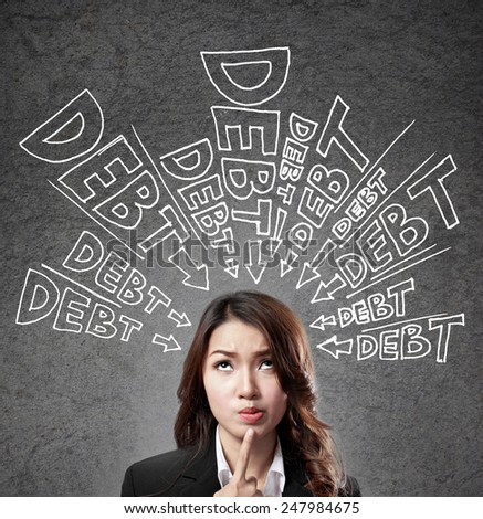 concept of a business woman thinking about her debt - stock photo