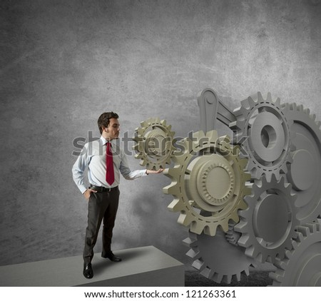 Concept of a businessman and mechanism of business - stock photo