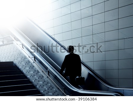 Concept of a businessman going to heaven on an escalator. Perfect shot for your religion or transportation advertising!