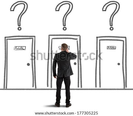 Concept of a Businessman that chooses the right door - stock photo