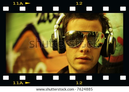 Concept of a Cool DJ movie star look - stock photo