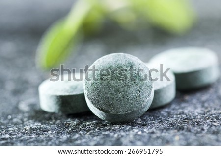 Concept of alternative medicine: Homeopathic natural spirulina pills close up