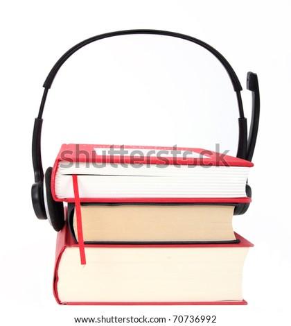 Concept of audio books, headphones and books on white - stock photo