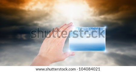 Concept of augmented reality - hand with abstract smartphone, weather forecast