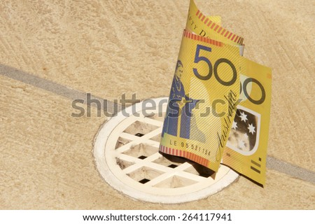 Concept of Australian Dollars Going Down the Drain - stock photo