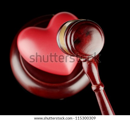 concept of broken heart because of divorce, isolated on black - stock photo