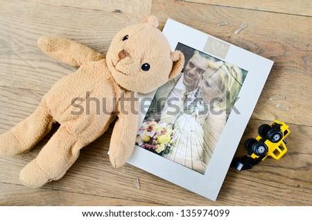 concept of broken marriage, broken photo frame of married couple - stock photo