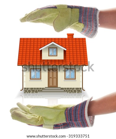 Concept of Building a House, an Abstract. Woman's Gloved Hands and Cottage Isolated on a white background. - stock photo