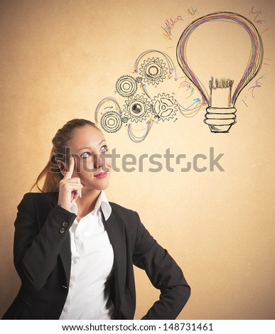 Concept of building an idea of a businesswoman - stock photo