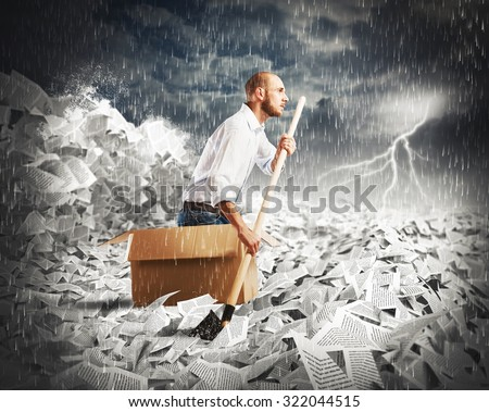 Concept of bureaucracy with man paddling in a sea of sheets - stock photo