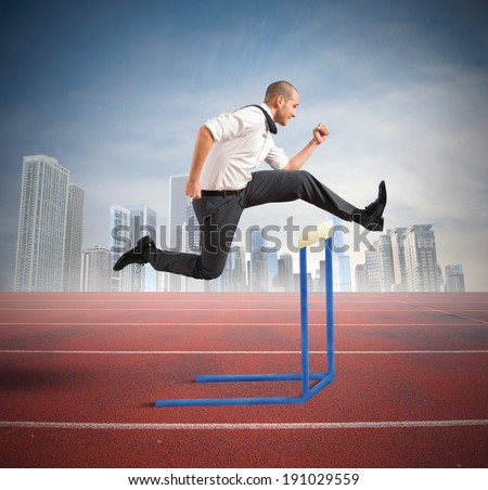 Concept of business difficulty with jumping businessman - stock photo