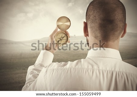 Concept of business direction with businessman and compass - stock photo