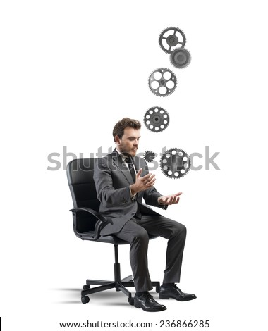 Concept of business game with juggler businessman with gear - stock photo