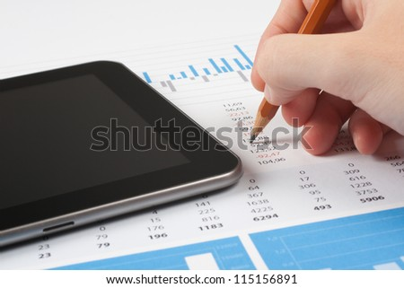 Concept of business report analysis - hand with pencil, digital tablet, graph and sheet. You may place your own screen, for example web page on tablet screen. - stock photo