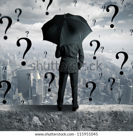 Concept of businessman surrounded by questions - stock photo
