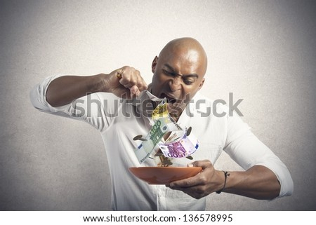 Concept of businessman that eats the money - stock photo
