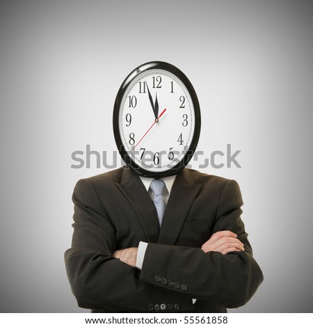 concept of businessman with a clock on the head - stock photo