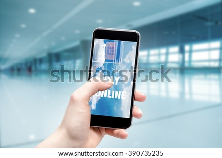 Concept of buying airline tickets online. Airport terminal in fuzzy depth of field. - stock photo