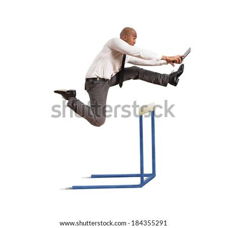 Concept of career difficulty with jumping businessman - stock photo