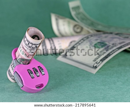 Concept of cash deposit - dollars with lock, on green backdrop - stock photo