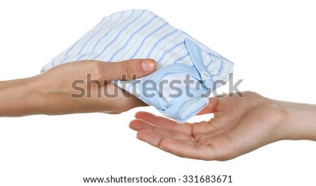 Concept of childish goods sale - woman's hands keep clothes pile isolated on white background