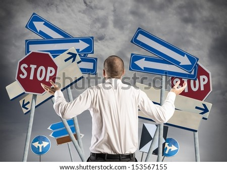Concept of Choices and confusion of a businessman - stock photo