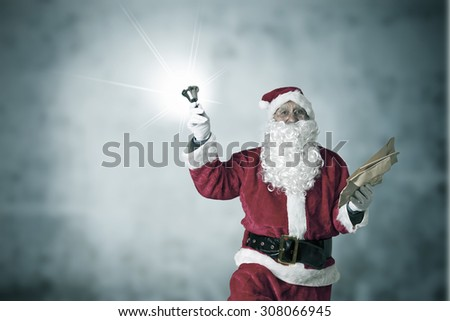 concept of christmas, Santa Claus with bell - stock photo