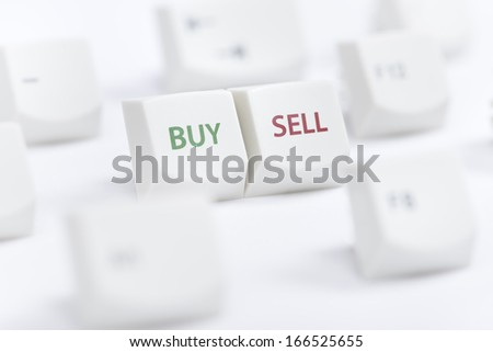 Concept of computer keyboard button with buy sell text sign on white background - stock photo