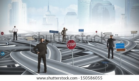 Concept of confused way of a businessman - stock photo
