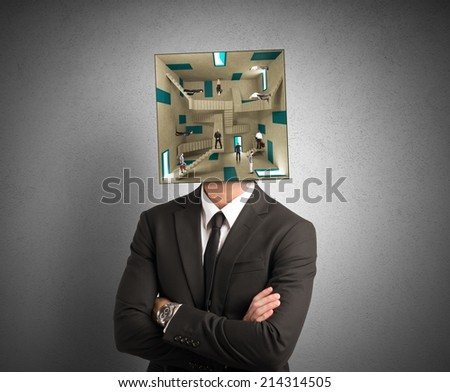 Concept of confusion man with a complex room for a head - stock photo