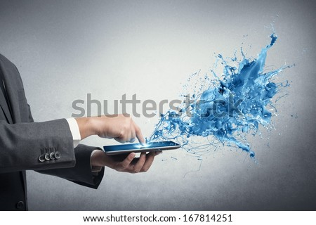 Concept of creative technology with businessman and tablet - stock photo