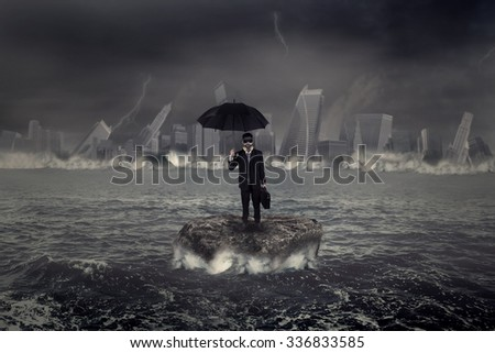 Concept of crisis storm in business with a businessman standing on the rock in the middle of a slight sea - stock photo