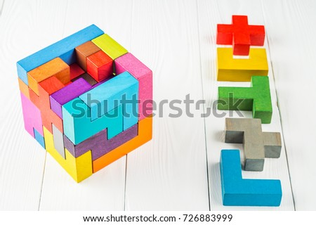 Concept of decision making process, creative, logical thinking. Geometric shapes in different colors. Choose correct answer. Logical tasks. Conundrum, find the missing piece of the proposed.