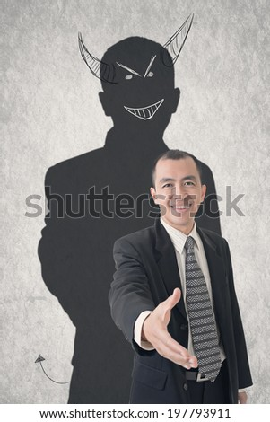 Concept of devil businessman with hand drawn evil shadow. - stock photo