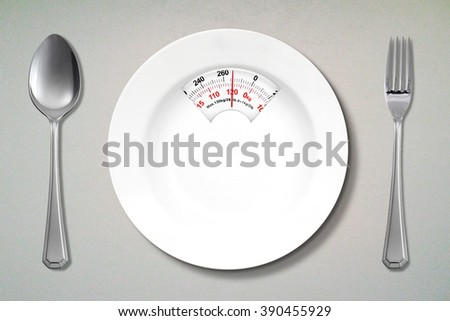 Concept of diet. Top view of empty dishware shaped a scale with fork and spoon on the table