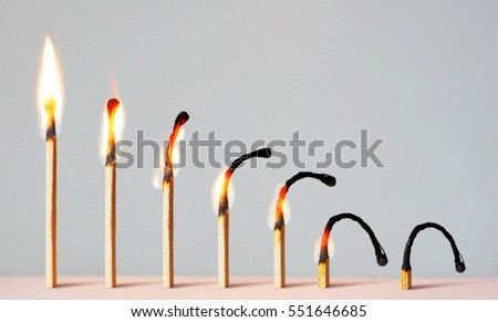 Concept of different phases in human life. Abstract image with burning matches