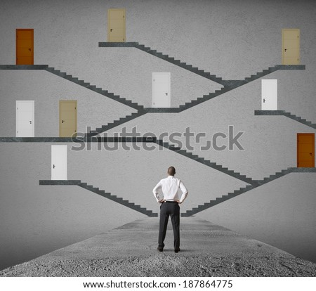 Concept of difficult choice of a businessman - stock photo