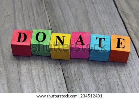 concept of donation word on wooden cubes - stock photo