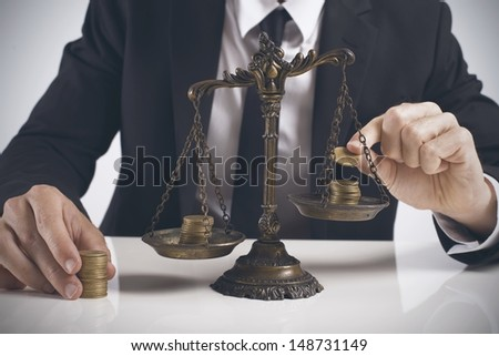 Concept of earning balance of a businessman - stock photo