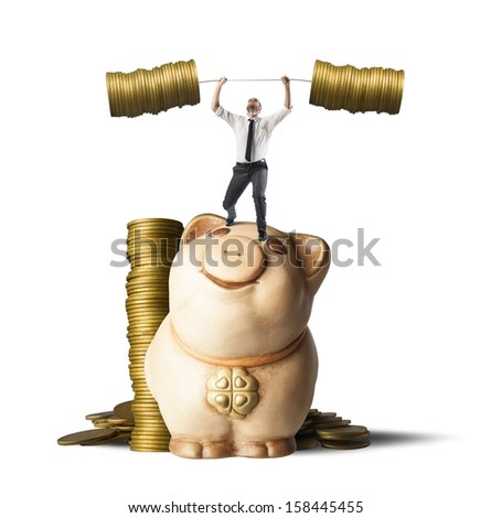 Concept of earning of a businessman who raises money as weights - stock photo