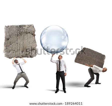 Concept of easy business with businessman holding a soap ball instead of the rock - stock photo