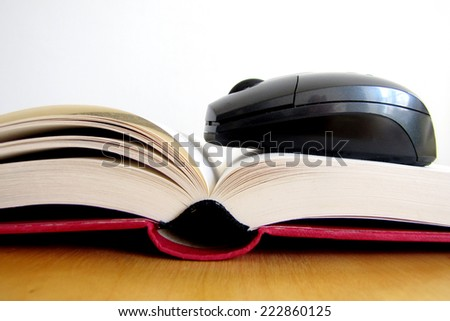 Concept of ebook. Book and mouse