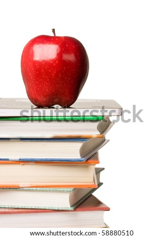 Concept of education. A red apple sitting on top of a stack of textbooks against white background. - stock photo