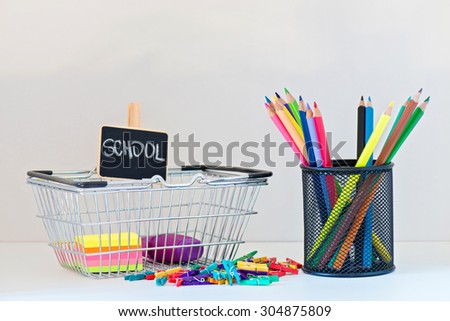 Concept of education. Back to School shopping. Items on the on the light-coloured shelf - stock photo