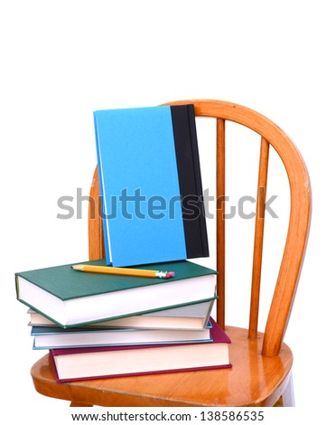 Concept of education: back to school with chair - stock photo