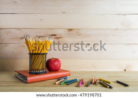 Concept of education or back to school on wood background