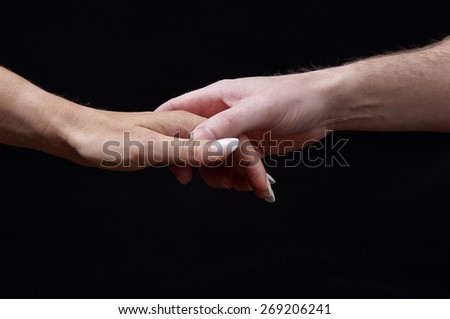 Concept of Emotions. Tenderness. The sense of touch expresses feelings and emotions through the contact with male and female hand - stock photo
