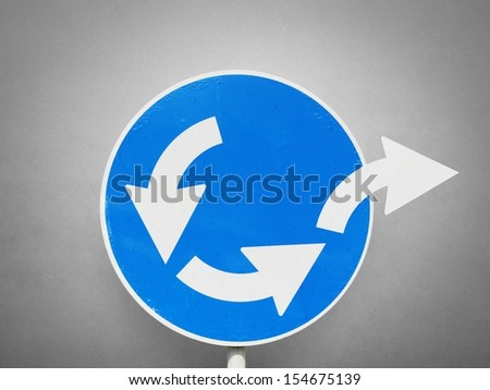 Concept of escape from business loop with road signal - stock photo