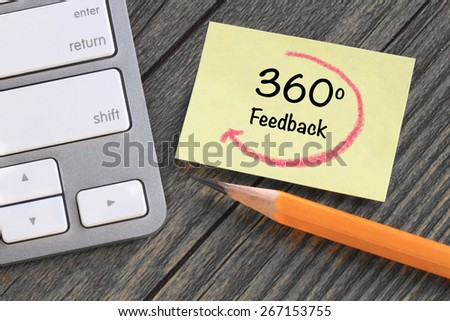concept of feedback, with desk background - stock photo